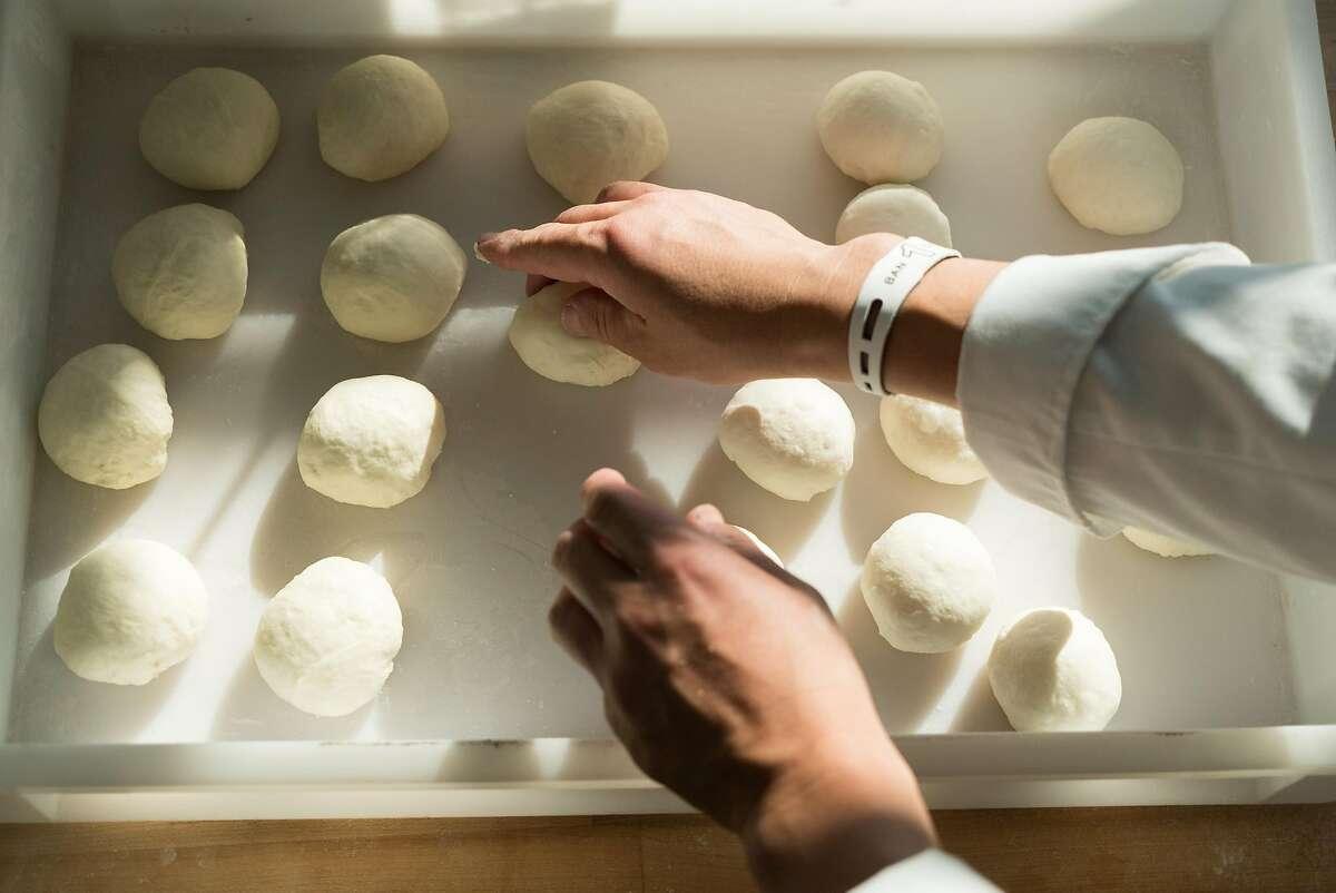 Nobu Hoyo prepares dough for baking at Voyagur du temps in Los Altos, Calif. on Saturday, April 30, 2016. Downtown Los Altos offers visitors boutique shops and bakeries.