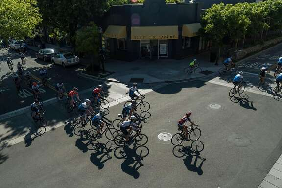 Members of Alto Velo begin their group ride in Los Altos, Calif. on Saturday, April 30, 2016. Downtown Los Altos offers visitors boutique shops and bakeries.