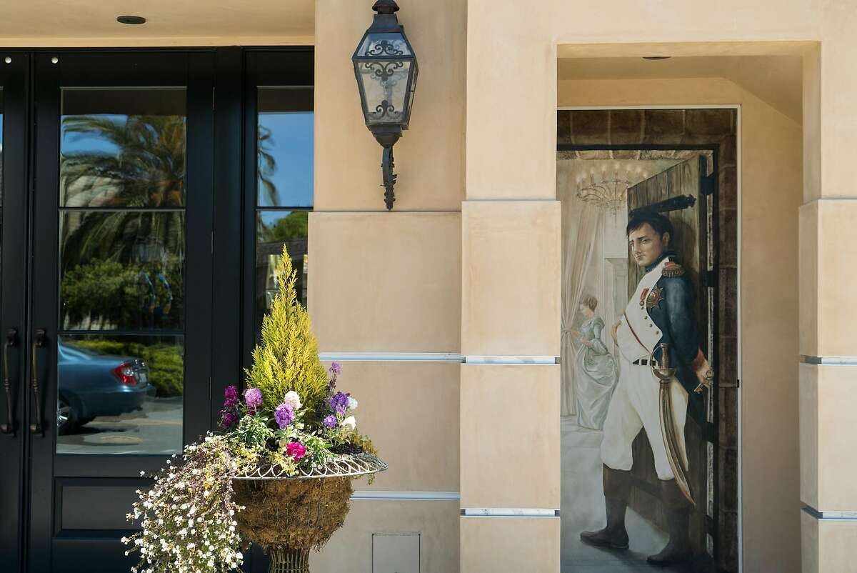 A mural of Napoleon is painted on the side of Enchante in Los Altos, Calif. on Saturday, April 30, 2016. Downtown Los Altos offers visitors boutique shops and bakeries.