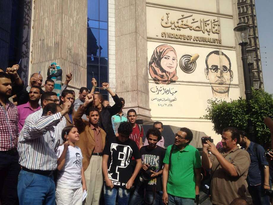 Protesters gather outside the offices of the Journalist Syndicate in Cairo. Police arrested two reporters, and the syndicate is demanding the dismissal of Egypt's interior minister. Photo: Brian Rohan, Associated Press
