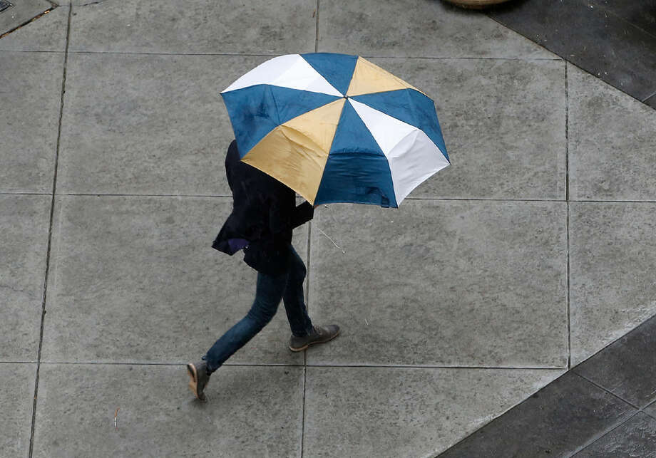 An April shower caused many people to grab an umbrella around the Bay Area. A similar small system could bring rain to the region on Wednesday. Photo: AP Photo/Rich Pedroncelli