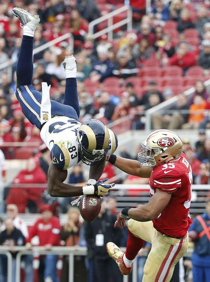 Eric Reid defends a pass against Rams wide receiver Brian Quick in the 2015 regular-season finale. Photo: Tony Avelar, Associated Press