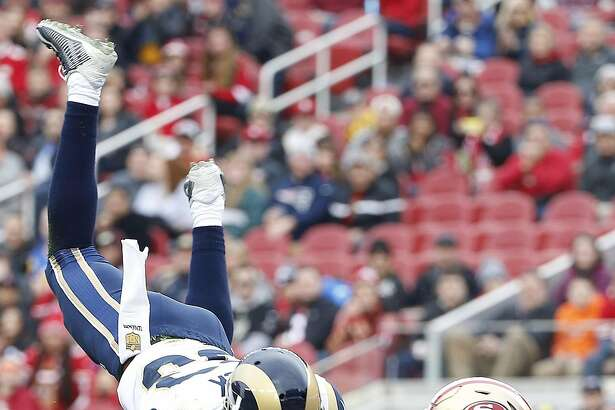 St. Louis Rams wide receiver Brian Quick (83) cannot catch a pass as he is defended by San Francisco 49ers safety Eric Reid (35) during the first half of an NFL football game in Santa Clara, Calif., Sunday, Jan. 3, 2016. (AP Photo/Tony Avelar)