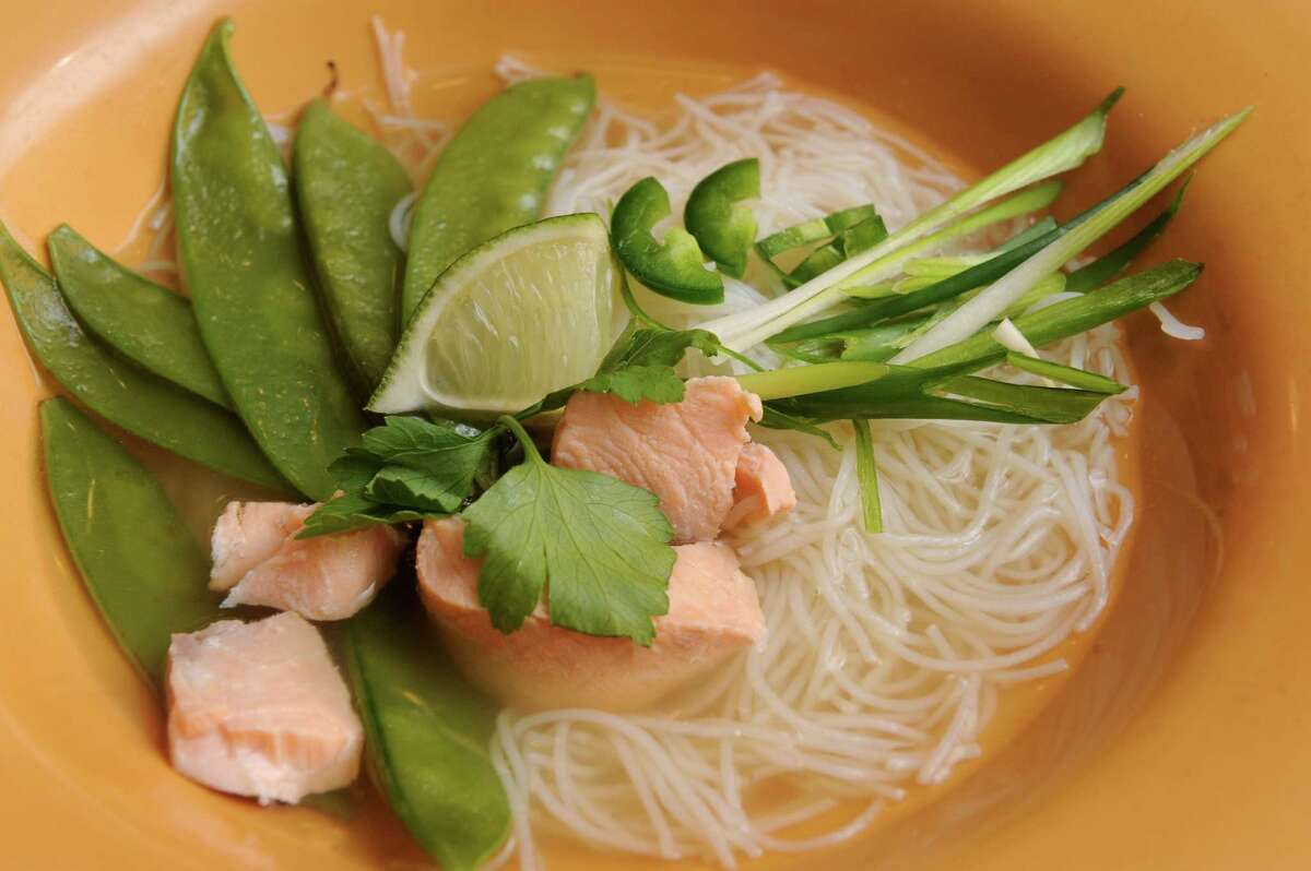 Thai tom yum with salmon, white onion, ginger and lime on Friday April 1, 2016 in Delmar, N.Y. (Michael P. Farrell/Times Union)