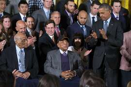 President Barack Obama applauds Hall of Fame baseball players Monte Irvin, left, and Willie Mays, center, during a ceremony in the East Room of the White House in Washington, Thursday, June 4, 2015, where the president honored the 2014 World Series champion San Francisco Giants baseball team. (AP Photo/Evan Vucci)