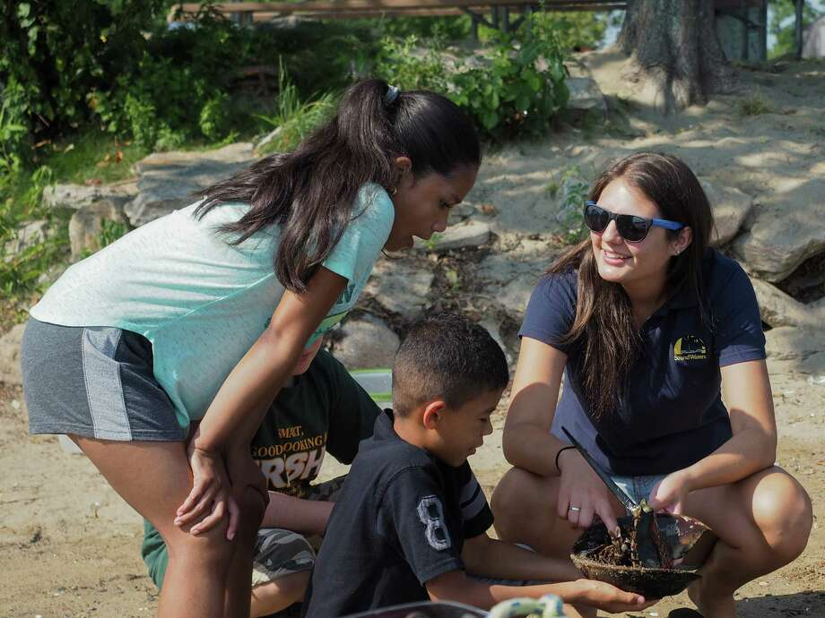 SoundWaters educator, Taylor Graham, leads STEM Academy students in a discussion of animal adaptations. SoundWaters received a $10,000 grant from Fairfield-based Near & Far Aid to support its STEM Academy. Photo: Henry Jiang
