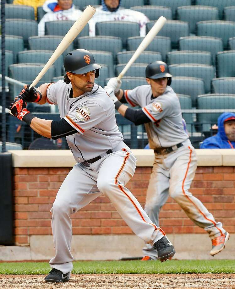 With Matt Duffy in the background pretending to be Angel Pagan, Pagan bats in the seventh inning Sunday, just before he singled and injured his left hamstring rounding first base. Photo: Jim McIsaac