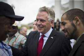 Virginia Gov. Terry McAuliffe speaks with citizens who had their voting rights restored after signing a sweeping order to allow more than 200,000 convicted felons to vote, circumventing the Republican-run legislature, in Richmond, Va., April 22, 2016. The action, in a swing state, could play a role in deciding the November presidential election, will enable all felons who have served their prison time and finished parole to register to vote.(Chet Strange/ The New York Times)
