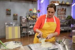 Susana Mijares, owner of Délice Chocolatier & Patisserie, tempers chocolate during Food Network's Spring Baking Championship. Photo courtesy Food Network.