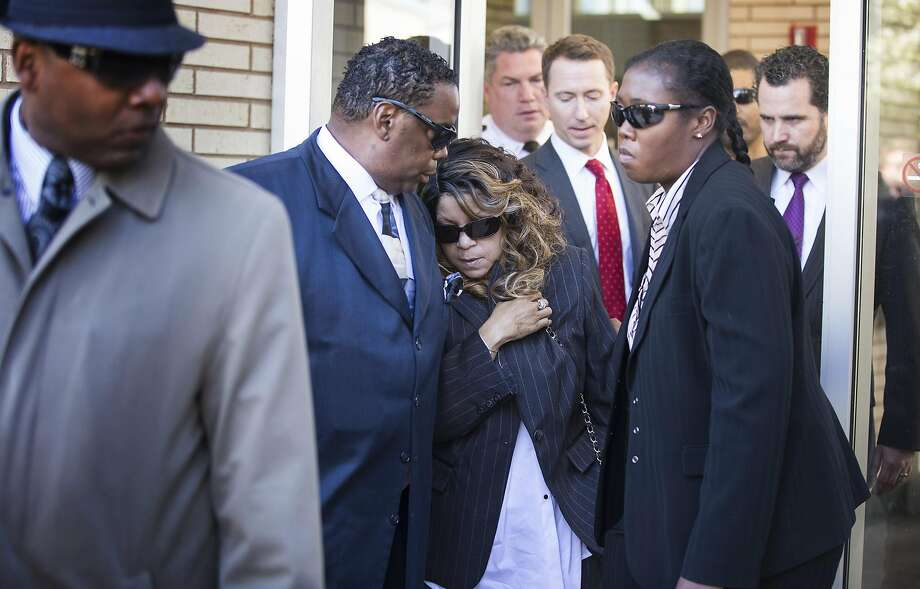 Prince's sister, Tyka Nelson (center), leaves the courthouse with her husband, Maurice Philips, in Chaska, Minn. No will has been found since the musician died unexpectedly last month. Photo: Leila Navidi, TNS