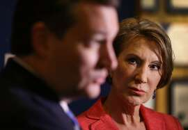INDIANAPOLIS, IN - APRIL 29:  Vice Presidential candidate and former Hewlett-Packard chief executive Carly Fiorina looks on as Republican presidential candidate Sen. Ted Cruz (R-TX) speaks with the media before participating in a taping of Fox News Channel's The Sean Hannity Show at the Indiana War Memorial on April 29, 2016 in Indianapolis, Indiana. Cruz continues to campaign leading up to the state of Indiana's primary day on Tuesday.  (Photo by Joe Raedle/Getty Images)