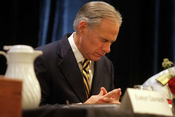 Texas Governor Greg Abbott participates in praying during the Texas National Day of Prayer Breakfast at the DoubleTree Hotel in Austin, Monday, May 2, 2016.