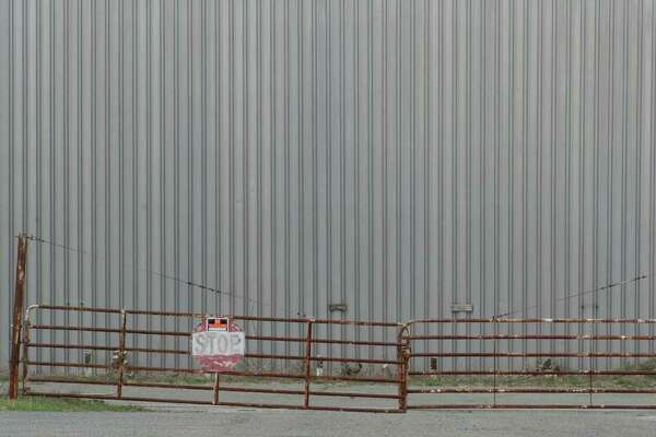 The Century Brass mill, on Scovill Road, in New Milford, Conn, is a 72 acre parcel with a 320,00 square-foot building , that is contaminated by PCB's and asbestos. Tuesday, April 22, 2014.