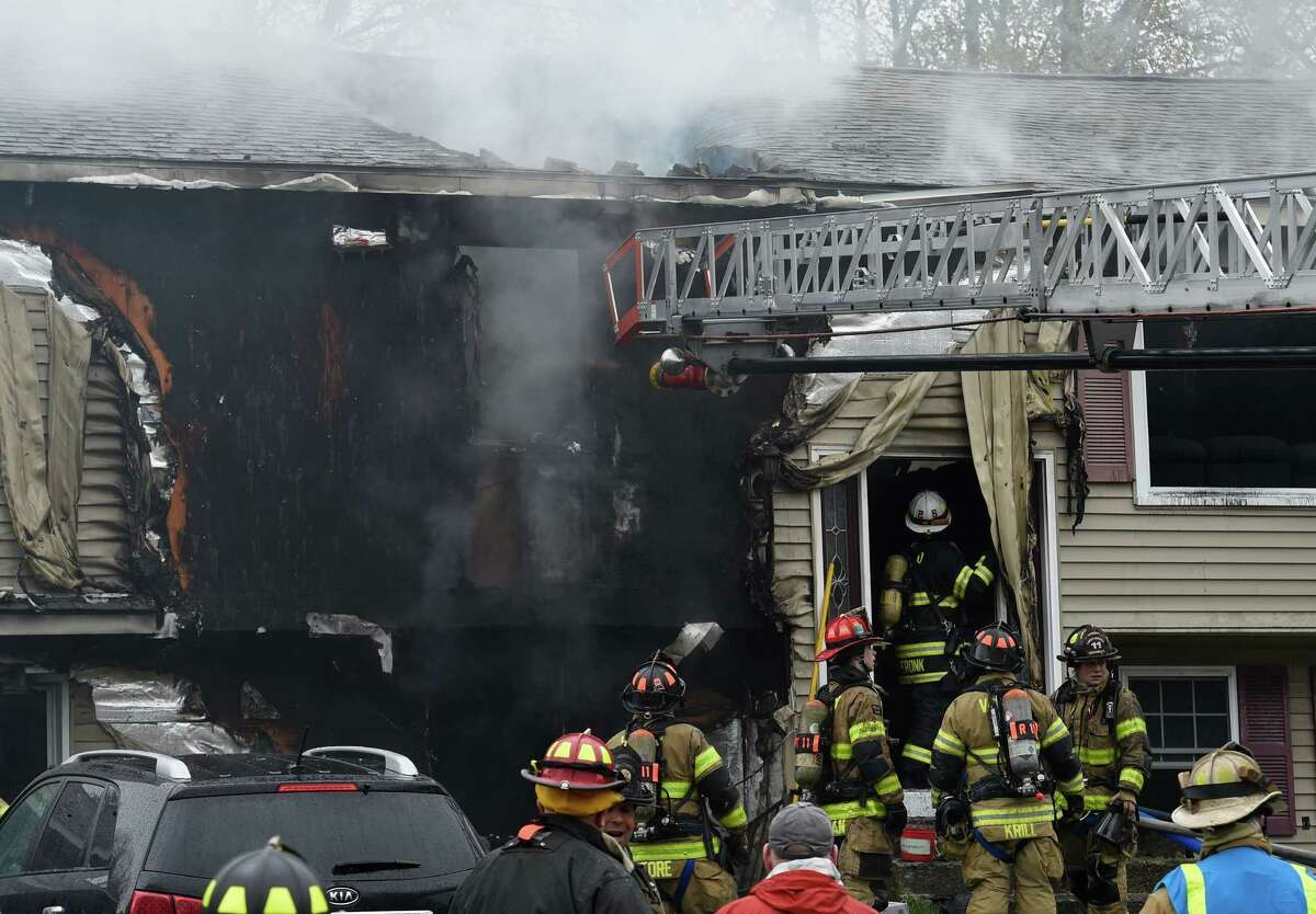A serious fire consumed a good portion of 16 Dussault Dr. during a mid-day fire on Monday, May 2, 2016, in Colonie, N.Y. Two men escaped and were taken to Albany Medical Center. (Skip Dickstein/Times Union)