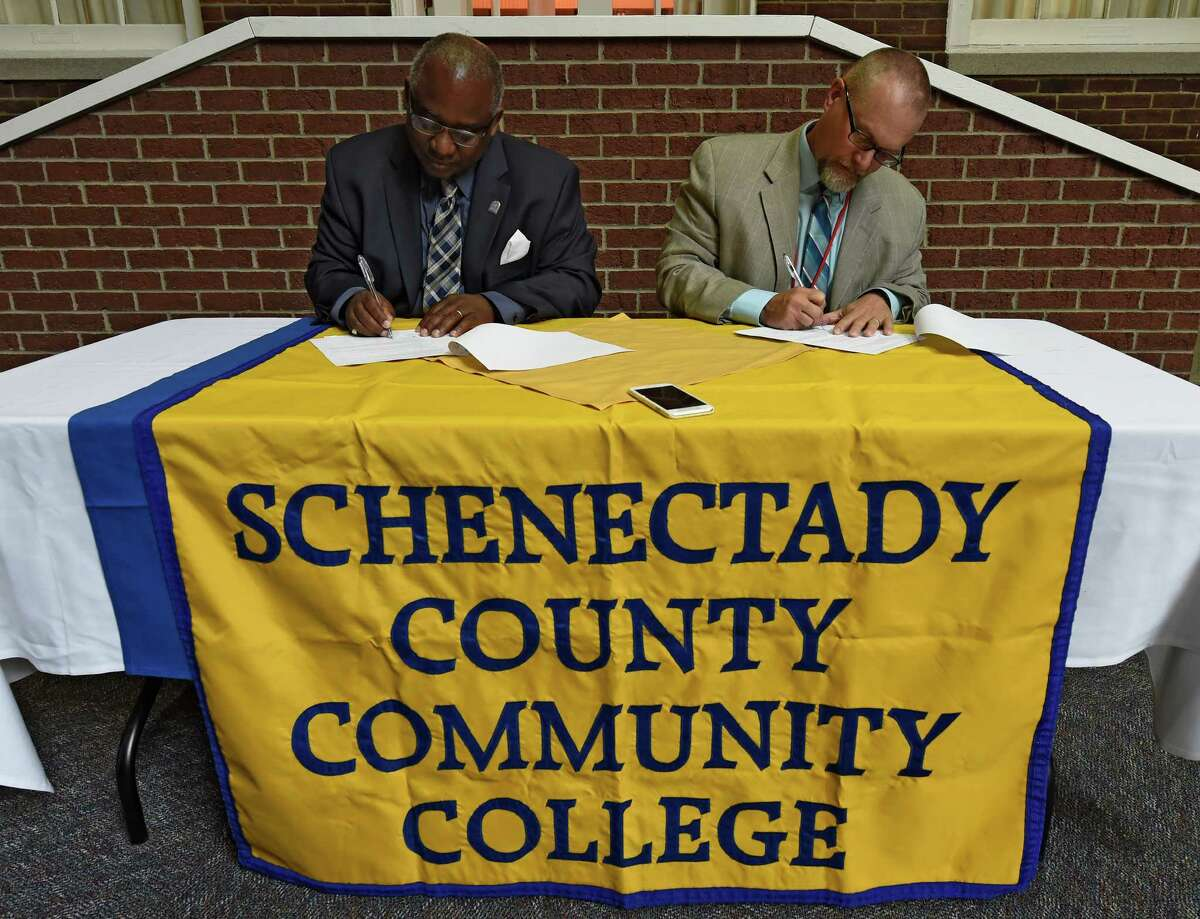 Schenectady County Community College(SCCC) president Dr. Steady H. Moono, left signs a memorandum of agreement with Niskayuna School Superintendent Dr. Cosimo Tangorra jr. Monday May 2, 2016 which will allow international students at the high school to continue their education at SCCC in Schenectady, N.Y. The agreement is the first of it's kind in the State. (Skip Dickstein/Times Union)