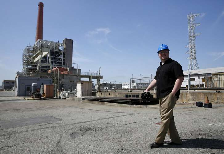 Sam Hamalian walks near the iconic 300-foot exhaust stack during a tour of the Potrero Hill Power Plant in San Francisco, California, on Monday, May 2, 2016.