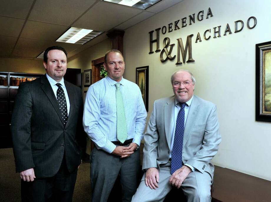 The Phil Spillane law firm, based in New Milford, recently merged with the Danbury based Hoekenga & Machado law firm. From left are, Attorneys Osvaldo Machado, Craig Hoekenga II and Phil Spillane, Monday, May 2, 2016. Photo: Carol Kaliff / Hearst Connecticut Media / The News-Times