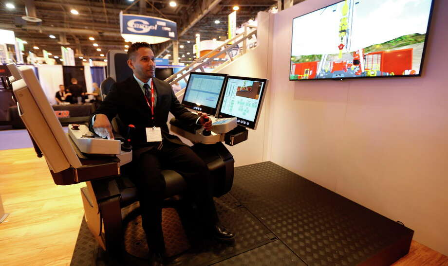 Vinesh Rambally, demonstrates the NOVOS Rise a rig operating system in the National Oilwell Varco booth at the 2016 Offshore Technology Conference at NRG Park, Monday, May 2, 2016, in Houston.  ( Karen Warren  / Houston Chronicle ) Photo: Karen Warren, Houston Chronicle / © 2016 Houston Chronicle