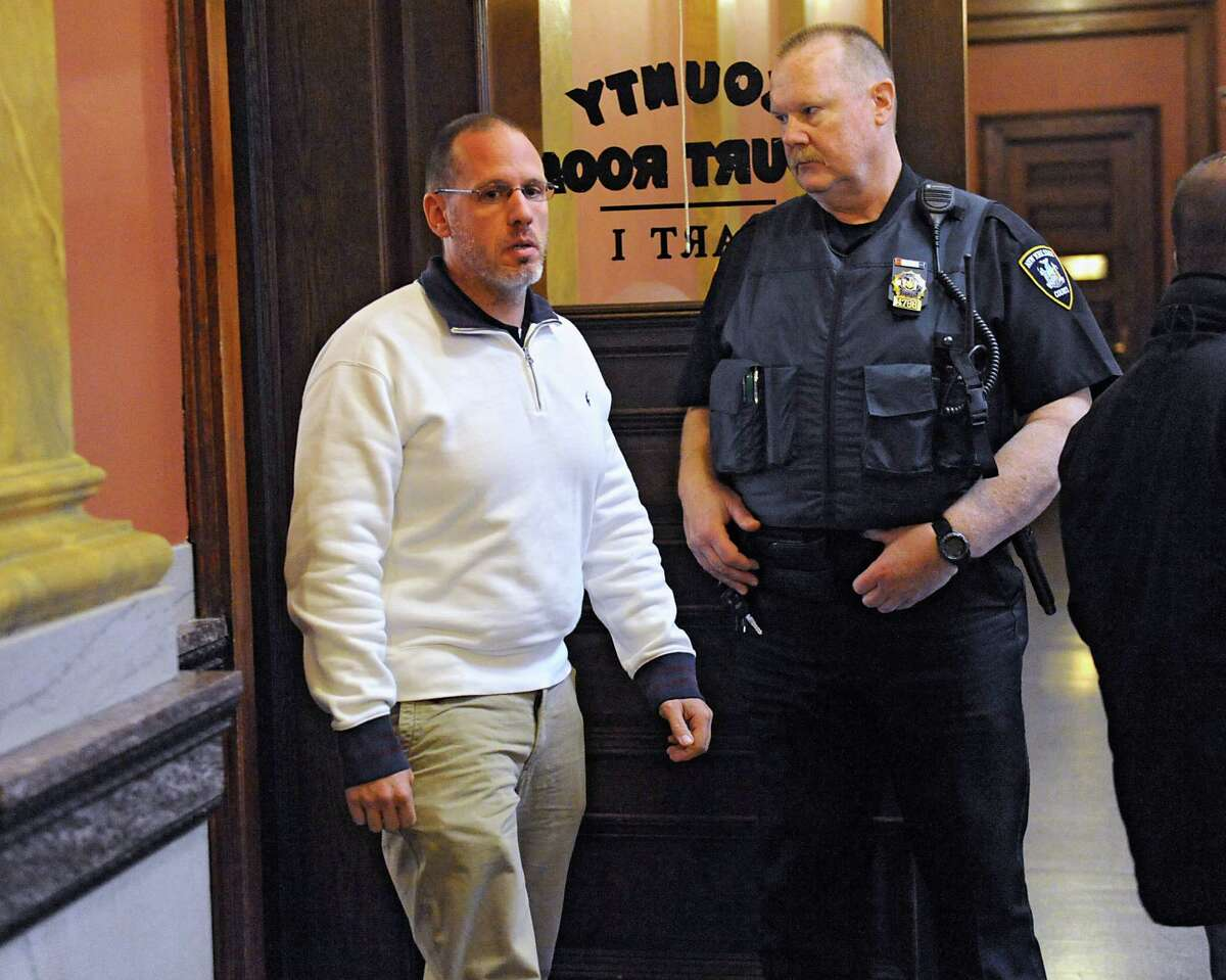 Troy police Sgt. Randall French leaves a courtroom where he was asked about the April 17 fatal shooting of a DWI as French testified in an unrelated trial at the Rensselaer County Courthouse on Monday, May 2, 2016, in Troy, N.Y. (Lori Van Buren / Times Union)