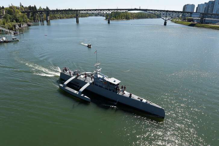 Sea Hunter, an entirely new class of unmanned ocean-going vessel gets underway on the Williammette River following a christening ceremony in Portland, Ore. Part the of the Defense Advanced Research Projects Agency (DARPA)'s Anti-Submarine Warfare Continuous Trail Unmanned Vessel (ACTUV) program, in conjunction with the Office of Naval Research (ONR), is working to fully test the capabilities of the vessel and several innovative payloads, with the goal of transitioning the technology to Navy operational use once fully proven. (U.S. Navy photo by John F. Williams)