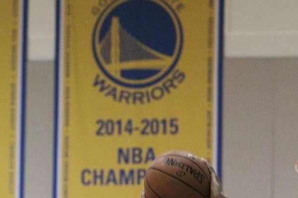 Andre Iguodala, Warriors guard-forward, shoots at baskets while practicing at the Warriors practice facility on Monday, May 2, 2016 in Oakland, California.