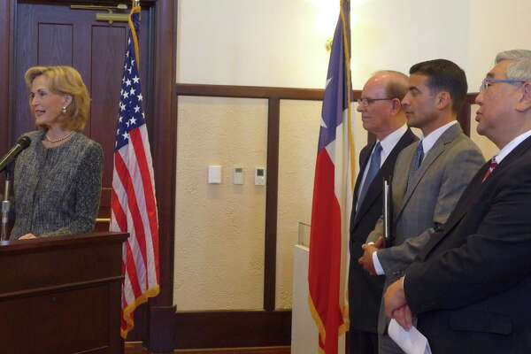 """L-R, Hidalgo Foundation President Tracy Wolff, Bexar County Judge Nelson Wolff, District Attorney Nicholas """"Nico"""" LaHood and District Judge Peter Sakai announce an early intervention program for the Children's Court in December. Since then, this and other measures, have had success in keeping families together."""