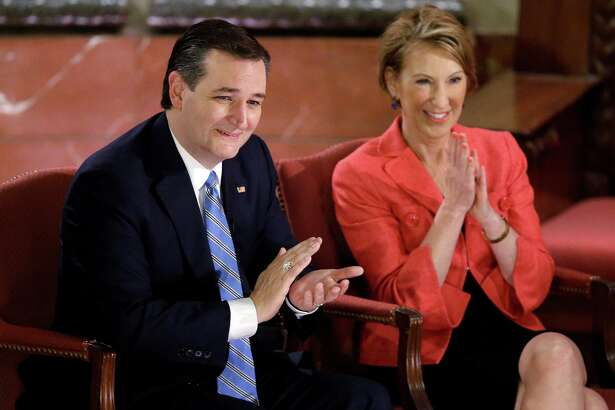 Republican presidential candidate, Sen. Ted Cruz, R-Texas, and vice-presidential candidate Carly Fiorina applaud during a question and answer session with Fox News Channel's Sean Hannity at The Indiana War Memorial on Friday.