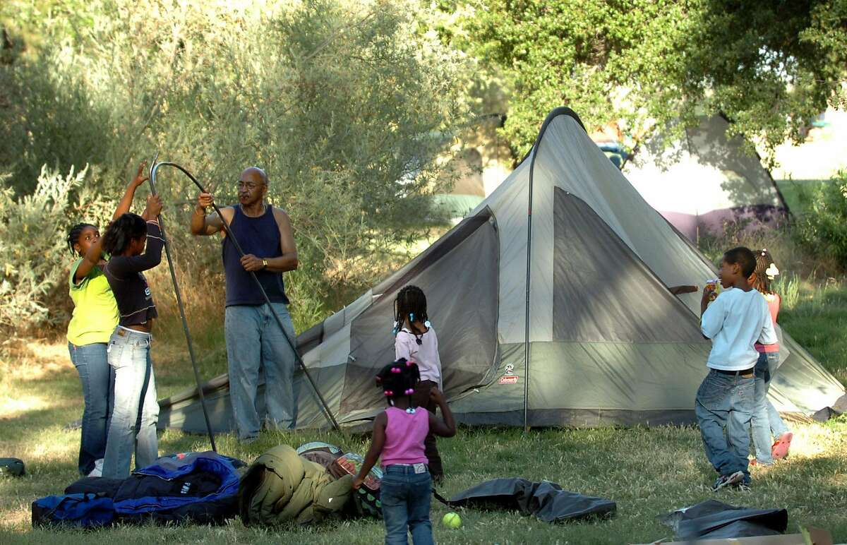 Brannan Island State Recreation Area - In this file photo James Brown, of Oakley, gets an assist from some younger members of the family while setting up a tent for a weekend of camping at Brannan Island State Recreation Area in Rio Vista, California.