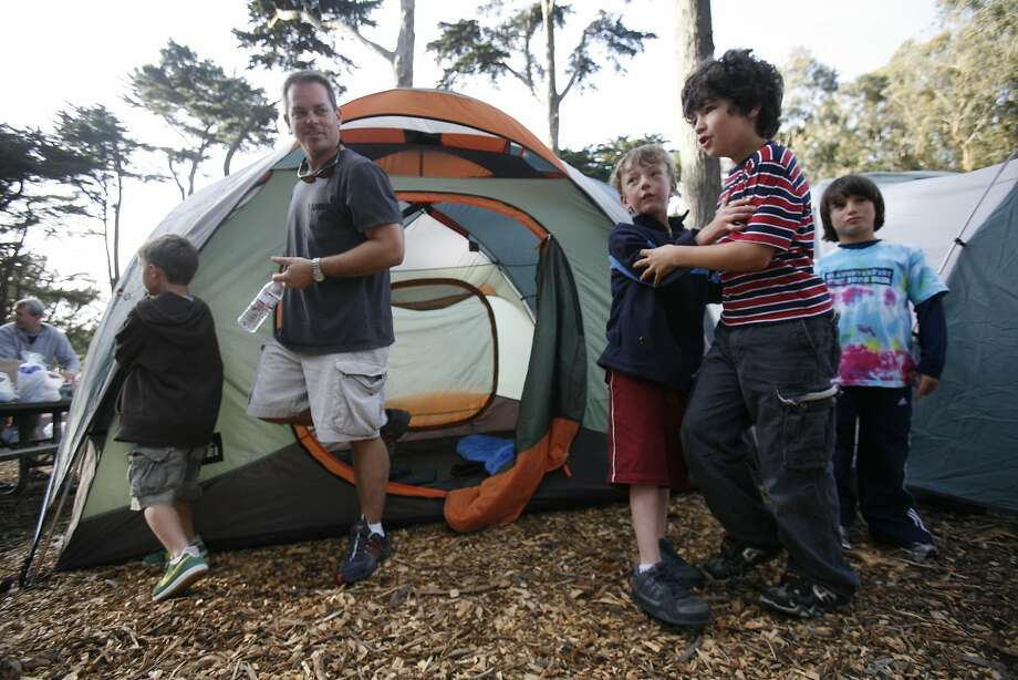 1st graders and their dads settle in at San Francisco's only official campground which is in the middle of the Presidio.  Photo: Mike Kepka, San Francisco Chronicle