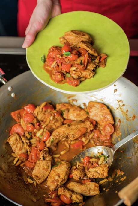 Chicken With Smoked Paprika and Almonds can be made with spinach  as well. Photo: Dixie D. Vereen / For The Washington Post