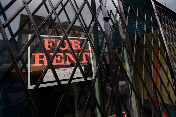 "CHICAGO - JULY 21:  A ""For Rent"" sign hangs in a vacant store window along Milwaukee Avenue in the Wicker Park neighborhood July 21, 2009 in Chicago, Illinois. The retail space vacancy rate in Chicago has topped 11 percent, the highest since the rate began to be tracked the first quarter of 1994.  (Photo by Scott Olson/Getty Images)"