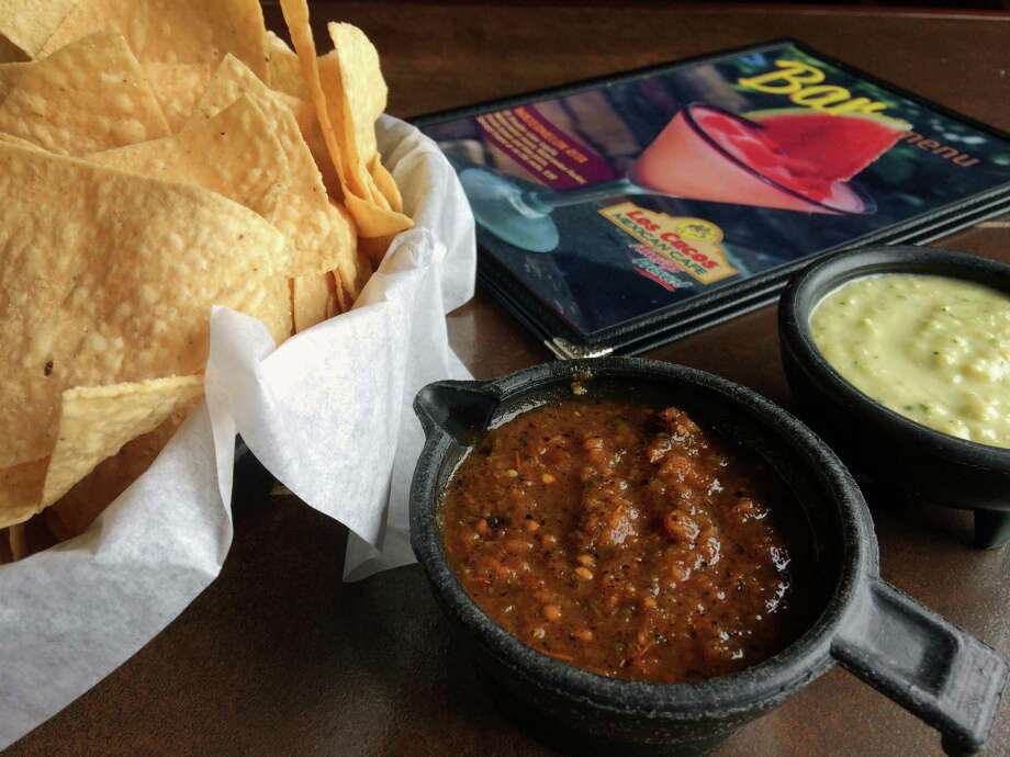 LOS CUCOS MEXICAN CAFEAddress: Seventeen Houston-area restaurants; loscucos.comSalsafication: The red salsa at this Houston-born chain is served warm in a cup with a pouring lip. With its roasted bits of red chilies and tomato, it is as pretty to look at as it is good to eat. Pleasant vinegar finish.Dos salsa?: Again, dos is a pale green cream sauce that is perked up with fresh cilantro.Free: Yes.Chips: They eat lighter than they look and that's a good thing.Grade: Very good.Other: For a decadent lunch or afternoon snack, try the seafood nachos. A small order is plenty as this is one rich dish, topped with crab, shrimp, Monterey Jack, sour cream and guacamole. And it goes down swell with a pucker-inducing margarita.