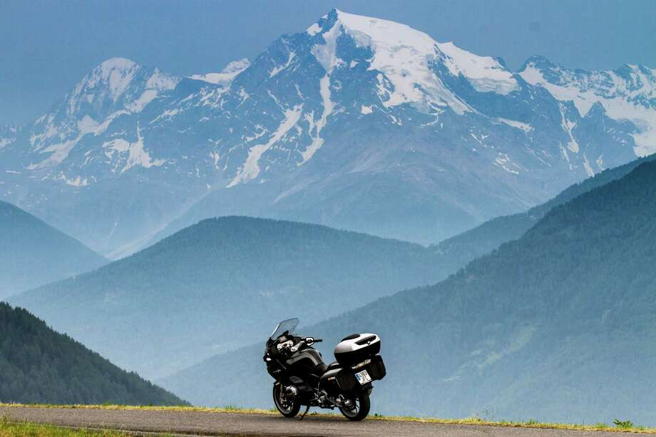 In this July 3, 2015 photo, a rented BMW motorcycle sits parked on a farm road in front of an Alpine view near Graun im Vinschgau, Italy. (AP Photo/Erik Schelzig) Photo: Erik Schelzig, STF / Copyright 2016 The Associated Press. All rights reserved. This material may not be published, broadcast, rewritten or redistribu