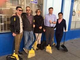 UNITE HERE/Local 2 staffers wielding brooms