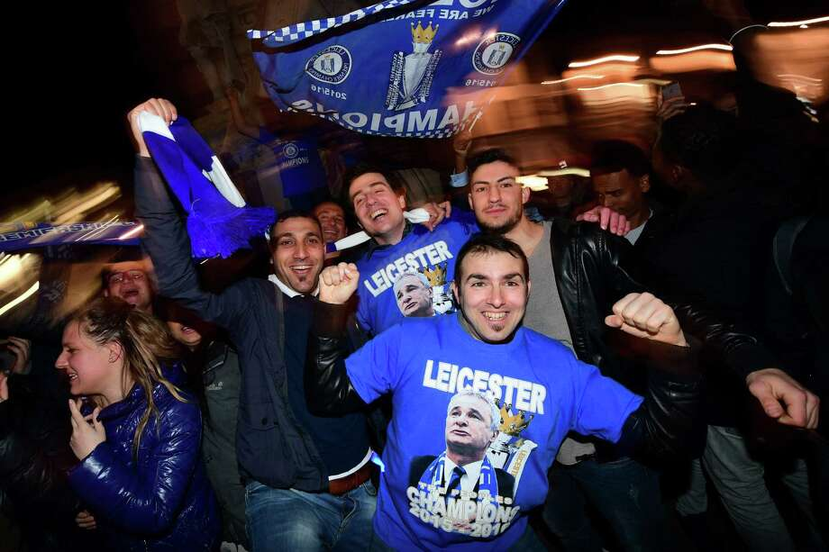 After barely avoiding relegation, Leicester began this season as 5,000-to-1 odds to win the Premier League crown. Remarkably, they clinched the first title in the club's 132-year history Monday. The EPL's last first-time champion was Nottingham Forest in 1978.  Photo: LEON NEAL, AFP/Getty Images / AFP or licensors