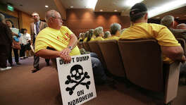Nordheim residents like Rodney Karnei protesting a permit for a nearby landfill at a Texas Railroad Commission hearing last year. The landfill would accept such soil contaminated by oil spills, drill cuttings, broken bits of rock and dirt that get drilled through on the way to finding oil and gas.
