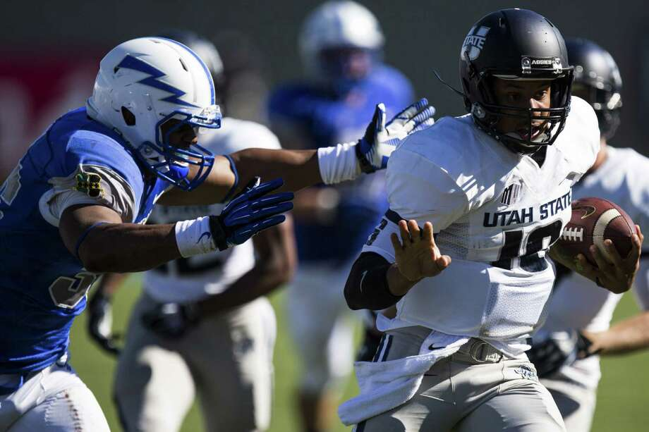 While at Utah State, Chuckie Keeton was one of the most productive quarterbacks in the nation when healthy. But he was limited to 16 games the last three seasons. Photo: Kent Nishimura, MBR / Colorado Springs Gazette