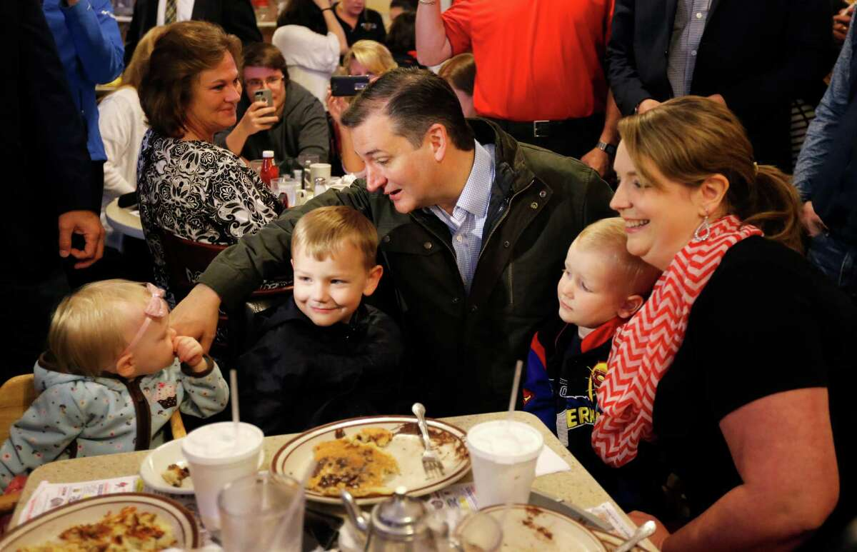 Ted Cruz talks with Elizabeth Craig's children during a campaign stop at a cafe in Osceola, Ind. Cruz promised Monday to continue to fight to stop Donald Trump from becoming the GOP presidential nominee.
