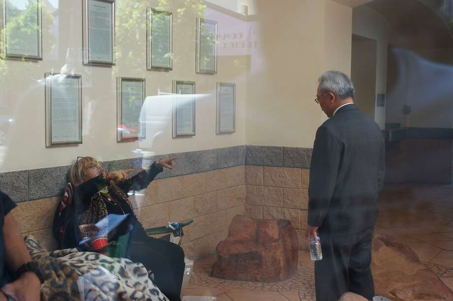 Maria Gutierrez, one of the hunger strikers demanding the removal of the police chief, confronts Mayor Ed Lee inside the Mission Police Station. Photo: Amos Gregory