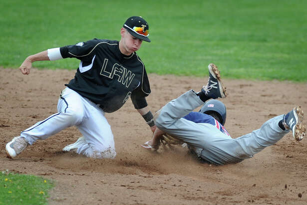 Foran's Jonathan Licktieg gets in ahead of the tag from Las shortstop Rob Griswold on a steal of second during Foran's 9-5 victory on Monday in Milford.