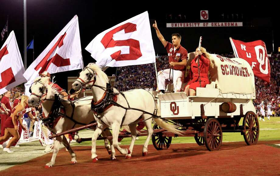 The Sooner Schooner and the Ruf Neks ride off the field after a Oklahoma touchdown against TCU during the second half of an NCAA college football game on Saturday, Oct. 5, 2013, in Norman, Okla. (AP Photo/Alonzo Adams) Photo: Alonzo Adams, Associated Press / FR159426 AP