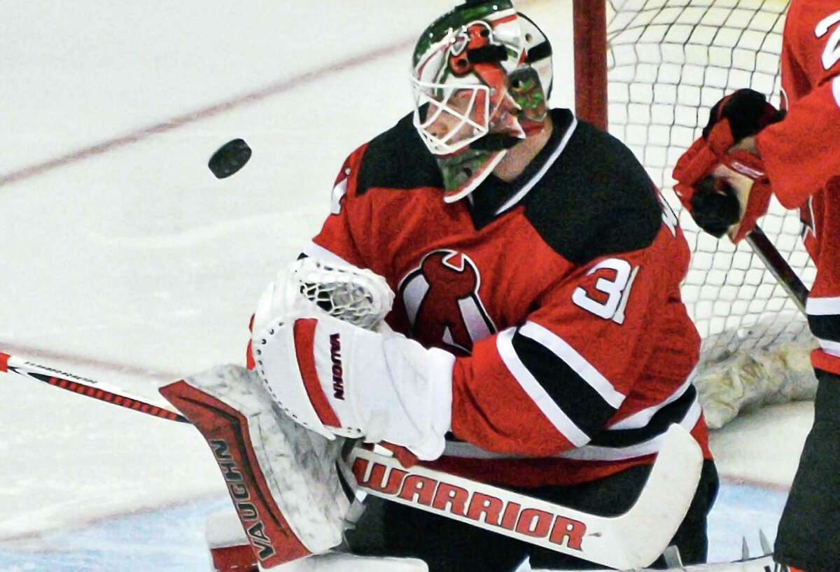 Albany Devils goalie Scott Wedgewood stops a Bridgeport Sound Tigers shot during Saturday's game at the Times Union Center April 16, 2016 in Albany, NY. (John Carl D'Annibale / Times Union) ORG XMIT: MER2016041620572866