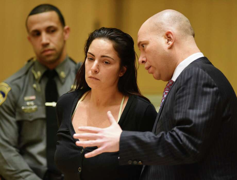 Former Stamford High School English teacher Danielle Watkins confers with her attorney, Rob Serafinowicz, during an arraignment at the Connecticut Superior Court in Stamford in 2015. Photo: File Photo / Hearst Connecticut Media / Greenwich Time