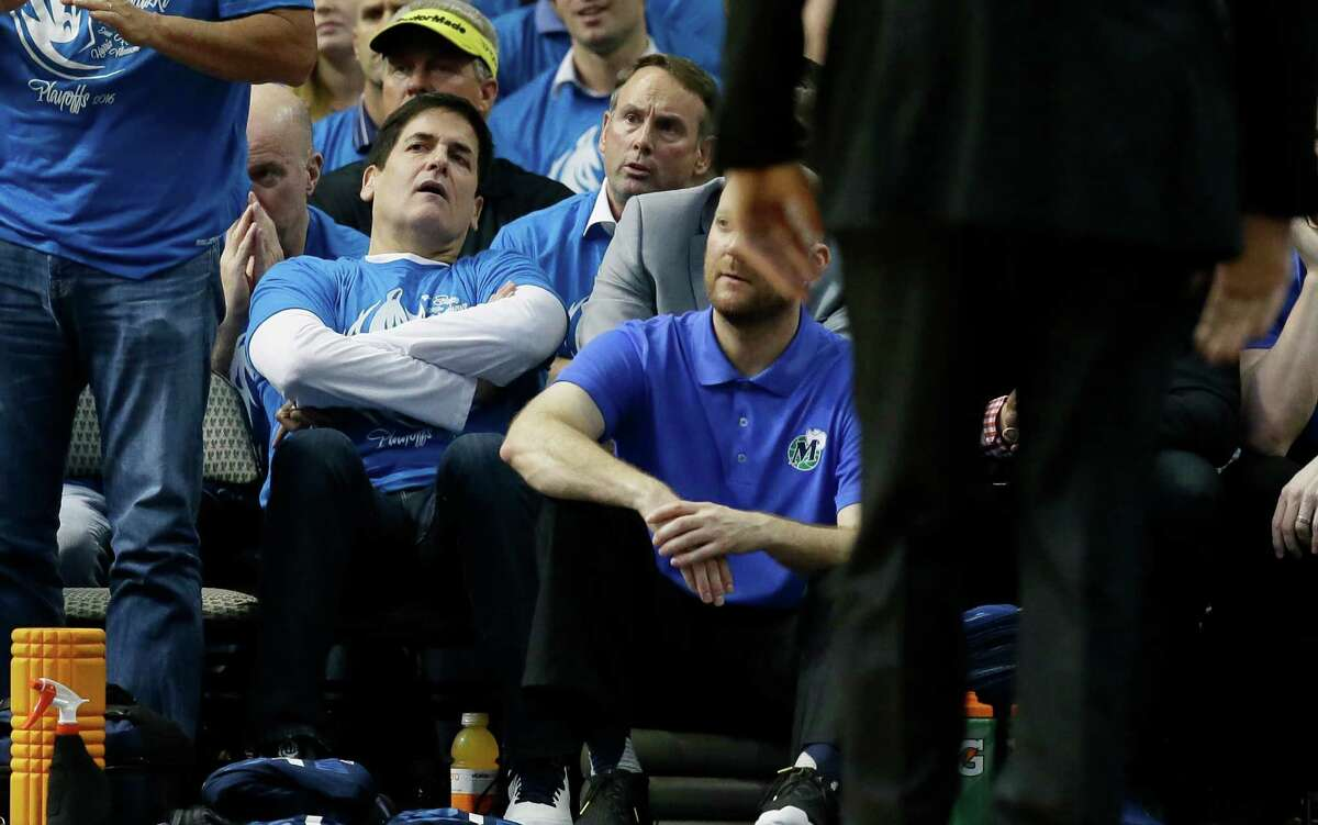 Dallas Mavericks owner Mark Cuban, left, watches during the fourth quarter Game 4 of a first-round NBA basketball playoff series against the Oklahoma City Thunder, Saturday, April 23, 2016, in Dallas. (AP Photo/LM Otero) ORG XMIT: DNA121