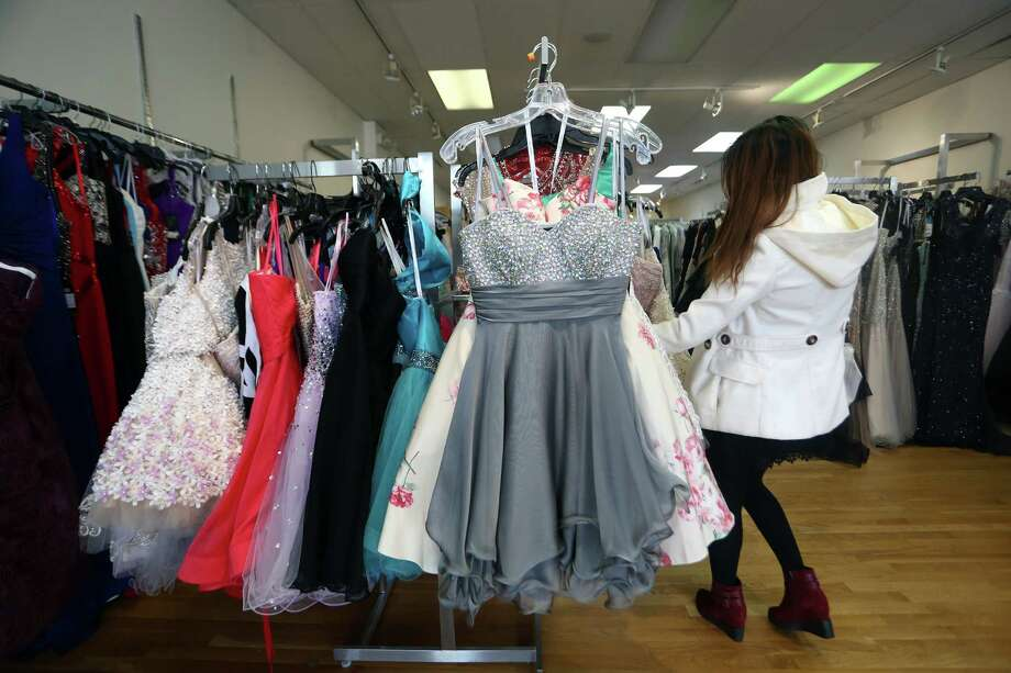 A woman browses the selection of dresses at A Step Ahead, on High Ridge Road, on Monday, May 2, 2016. The dress shop was recently embroiled in controversy after hanging a sign in their front window that read 'Prom Rules: Dress Safely' which many interpreted as promoting rape culture. Photo: Michael Cummo / Hearst Connecticut Media / Stamford Advocate