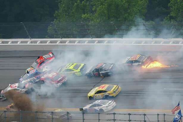 Several cars collide in a crash during the NASCAR Talladega auto race at Talladega Superspeedway, Sunday, May 1, 2016, in Talladega, Ala. (AP Photo/John Bazemore) ORG XMIT: ALBA506
