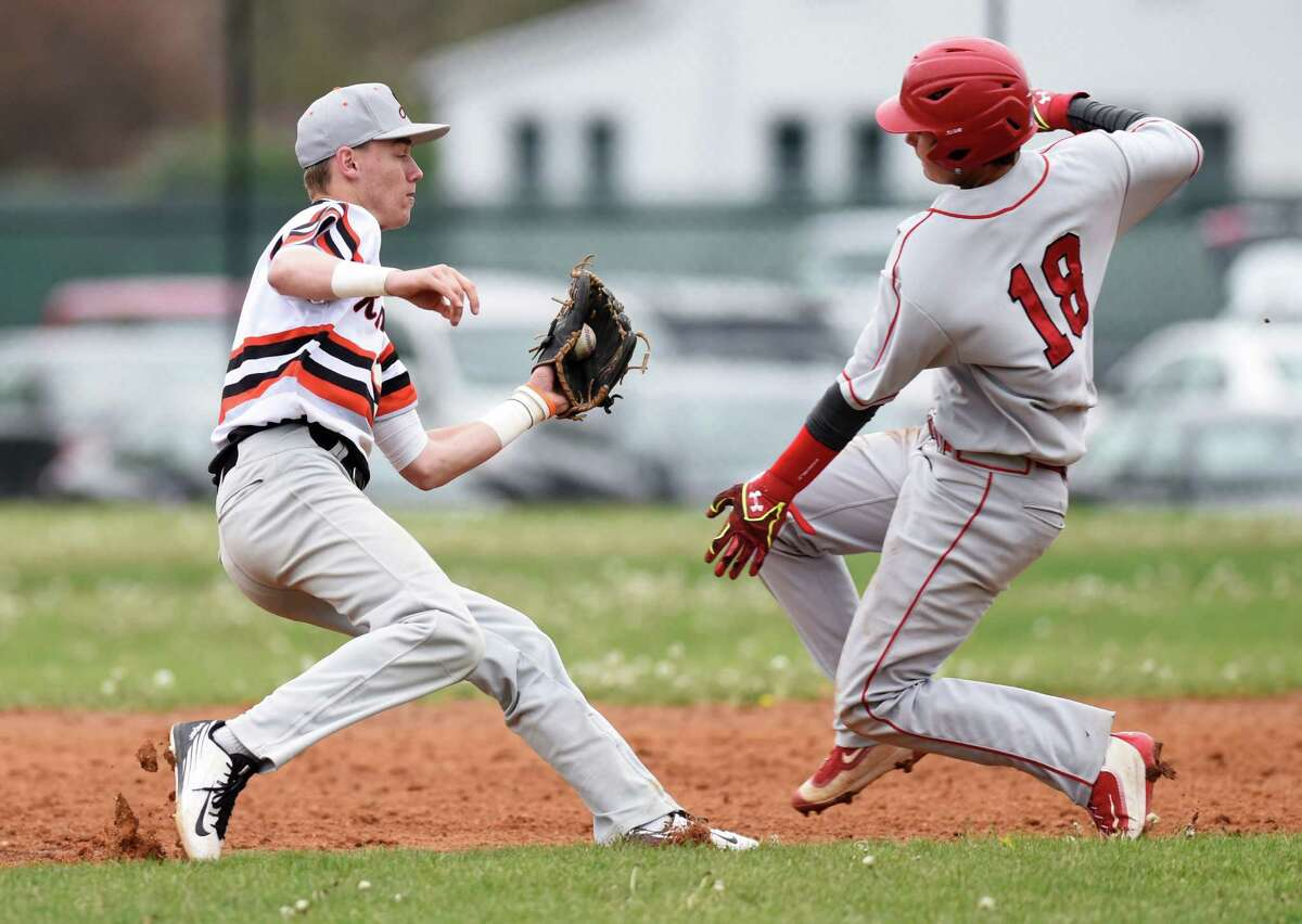 Stamford shortstop Jay DeVito tags out Greenwich baserunner Colin Kelly in Greenwich's 4-3 win over Stamford in the high school baseball game at Stamford High School in Stamford, Conn. Monday, May 2, 2016.