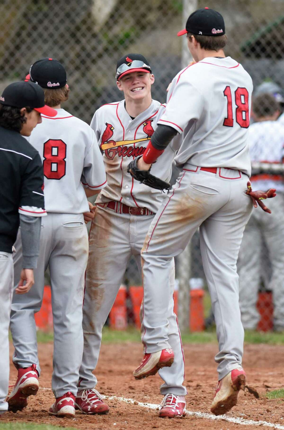 Greenwich's Michael McGrath, center, celebrates with teammate Colin Kelly (18) after Greenwich's 4-3 win over Stamford in the high school baseball game at Stamford High School in Stamford, Conn. Monday, May 2, 2016.