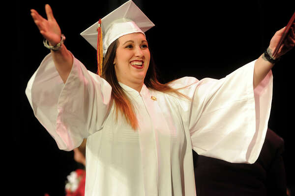 Nicole Cavallaro, of North Haven, opens her arms for a hug after receiving her diploma during the Bridgeport Hospital School of Nursing graduation at the University of Bridgeport in Bridgeport, Conn. on Monday, May 2, 2016.
