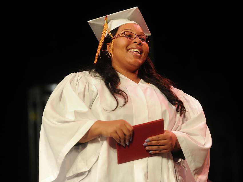 Bridget Robinson, of Bridgeport, smiles as she receives her diploma at the Bridgeport Hospital School of Nursing graduation at the University of Bridgeport in Bridgeport, Conn. on Monday, May 2, 2016.